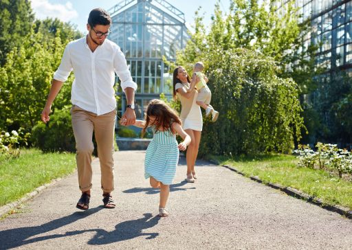 67275801 - family having fun outdoors. beautiful happy smiling young people and their children playing together in garden. parents and kids spending leisure time together outside. love and relationships concept